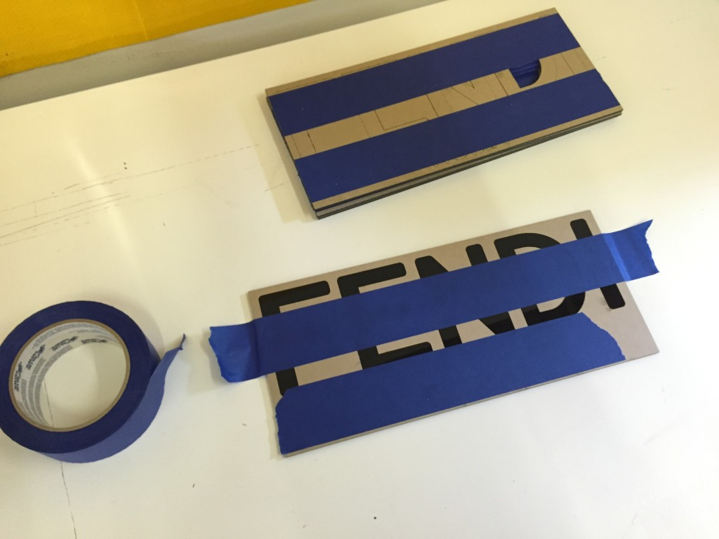 prepare laser cut acrylic sign for instalation on location