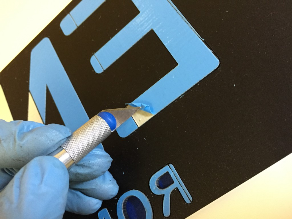 removing adhesive protector of laser cut sign letters